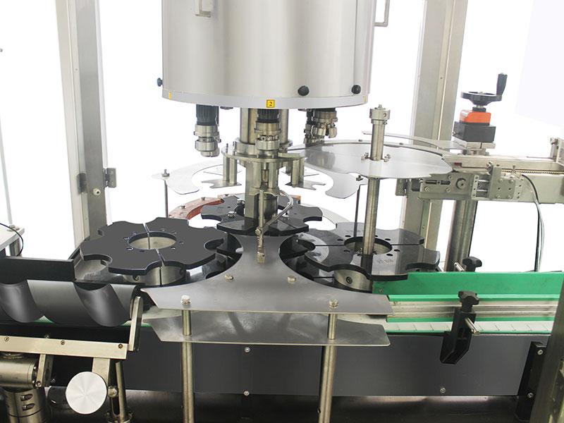 Podrobnosti samodejnega rotacijskega stroja za zapiranje s 6 glavami