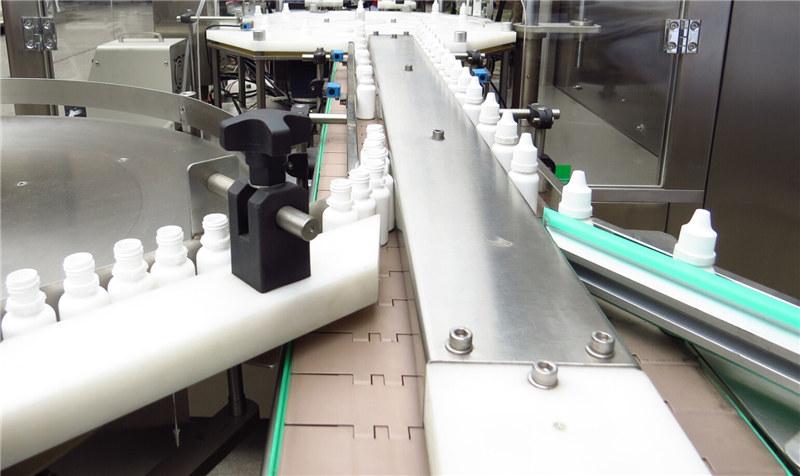 Stroj za polnjenje in zapiranje kapljic